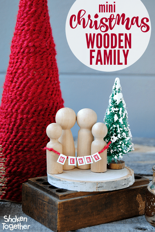 I cannot handle the cuteness of this Mini Christmas Wooden Family! LOVE the bottle brush tree and teeny tiny banner!