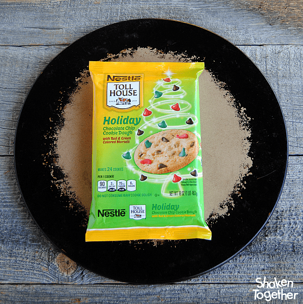 This Cookies & Milk Dessert Pizza gets an easy start with Nestle holiday chocolate chip cookie dough!