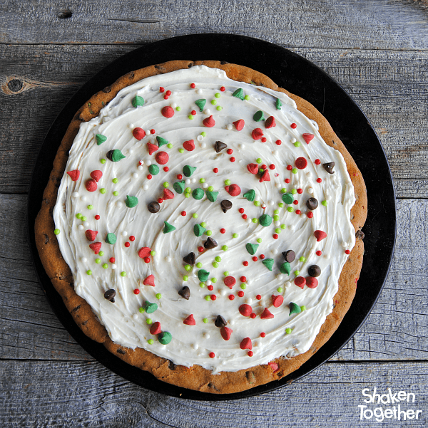 For the final touch, add a generous drizzle of holiday sprinkles to the top of the Cookies & Milk Dessert Pizza!
