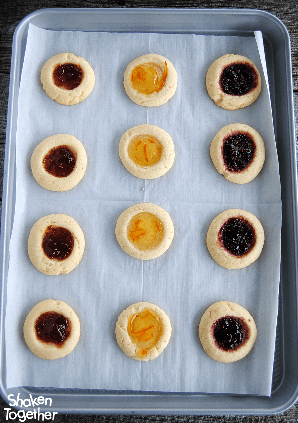 I love how the jam gets all glossy and gorgeous as these Jam Thumbprint Cookies bake!