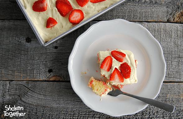 Lemon Strawberry Poke Cake on a white plate