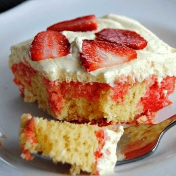 lemon strawberry poke cake with bite on fork