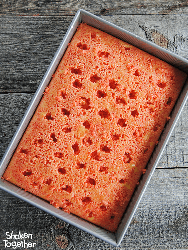Lemon Strawberry Poke Cake - poke holes in baked lemon cake