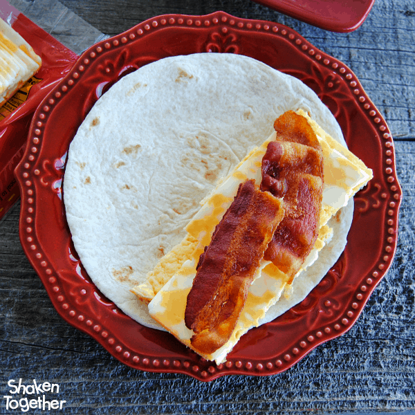 Add crispy bacon (or your favorite breakfast meat) as the final layer for our Breakfast Soft Tacos!