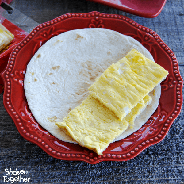 Make a pan of sheet pans eggs to make the assembly of these Breakfast Soft Tacos easy!