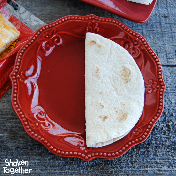 Fold tortillas in half to making stuffing your Breakfast Soft Tacos a little easier!