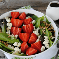 This Simple Strawberry Balsamic Salad is easy to throw together and packs a ton of flavor - perfect for those warm weather parties and picnics!