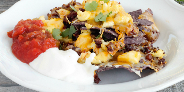 Start the Cinco de Mayo fiesta early with a big tray of our Breakfast Nachos! Loaded with cheese, scrambled eggs and chorizo, we love to top the with salsa and Mexican creama!
