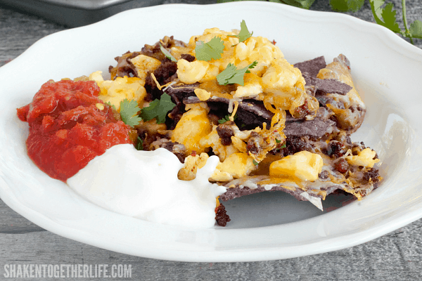 Start the Cinco de Mayo fiesta early with a big tray of our Breakfast Nachos! Loaded with cheese, scrambled eggs and chorizo, we love to top them with salsa and Mexican creama!