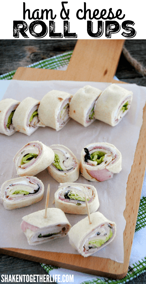 Easy Ham & Cheese Roll Ups - Layers of flavored cream cheese, ham, cheese and crisp lettuce rolled up in soft tortillas! Perfect for lunch boxes and parties!