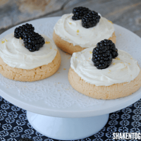 Need a quick dessert? Give bakery cookies a delicious makeover! Our Lemon Cream Cheese Frosted Cookies are topped with an easy frosting and ripe, plump blackberries!