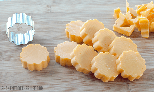 Use a mini flower cookie cutter to make flower shaped cheese rounds for Berry Brunch Kabobs!