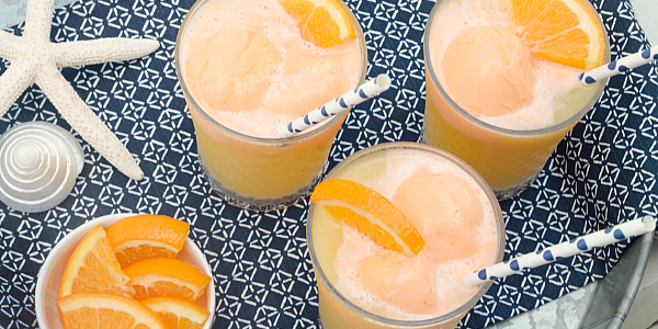 Tropical fruit juices, lemon lime soda and orange sherbet make this Tropical Orange Sherbet Punch the perfect Summertime drink!