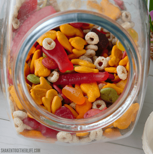 Stir together a big bowl of our colorful, sweet and salty Shark Week Snack Mix for Shark Week, a shark or ocean themed party, a trip or Sea World or a Nemo and Dory movie day!