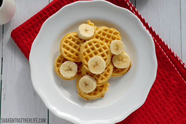 Sliced bananas top mini waffles for our Banana Berry Breakfast Nachos!