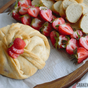 Strawberry Jalapeno Baked Brie is a little appetizer with a BIG flavor! Try spreading a halved strawberry with the melty cheese - YUM!