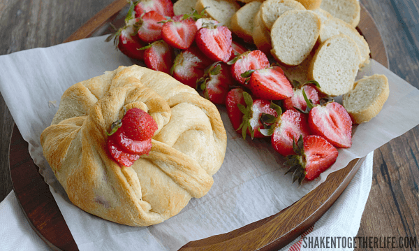 Strawberry Jalapeño Baked Brie is a little appetizer with a BIG flavor! Try spreading a halved strawberry with the melty cheese - YUM!