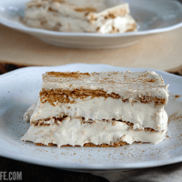 Pumpkin Spice Eclair Cake - the perfect dessert to ease from Summer to Fall! This no bake dessert packs a big pumpkin spice punch!