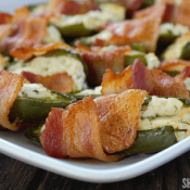 Bacon Wrapped Jalapeño Popper Halves are perfect for game day, potlucks and parties. With 2 unexpected ingredients, these will fly off the table!