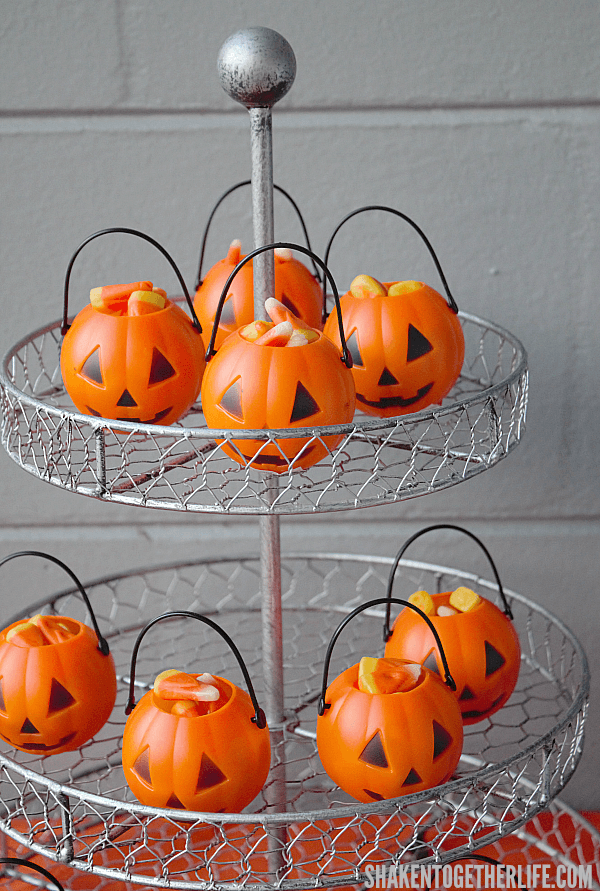 Candy corn filled mini jack-o-lanterns are an easy addition to your Halloween Dessert Bar!
