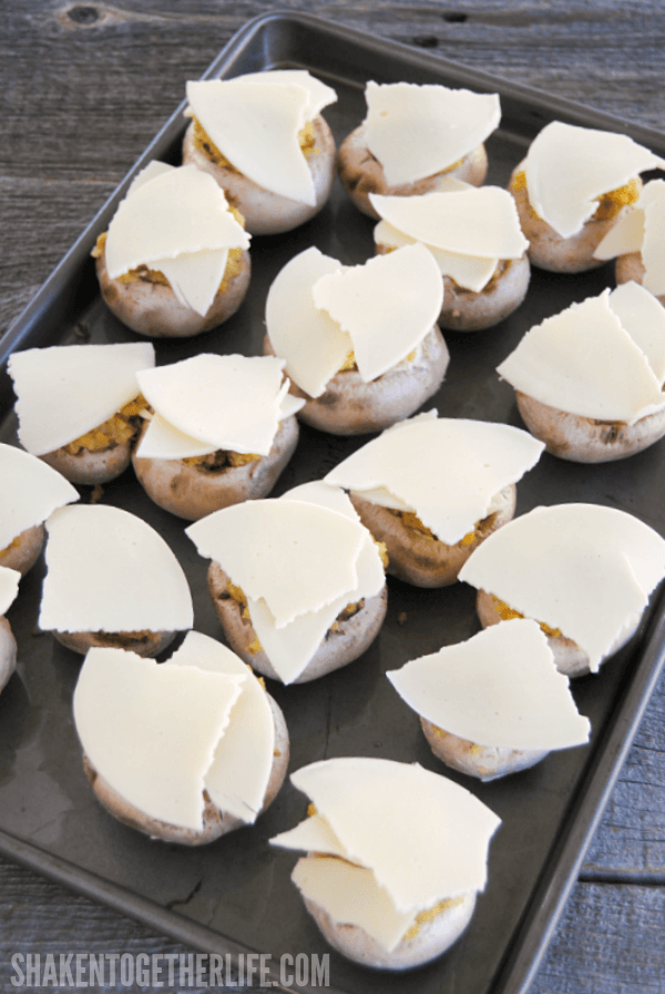 Top each stuffing stuffed mushroom with your favorite sliced cheese