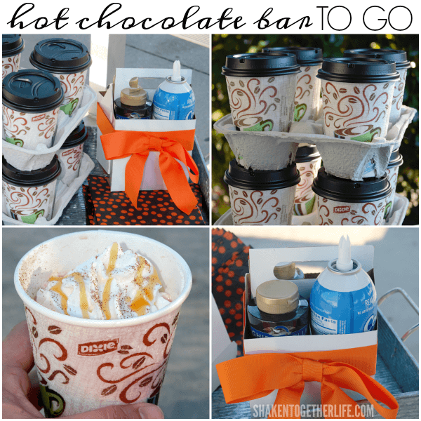 An Easy Hot Chocolate Bar to Go is the perfect way to warm up at an early morning game, practice or event! Steaming cups of hot chocolate get topped with caramel, chocolate, cinnamon and whipped cream all from the comfort of the bleachers!
