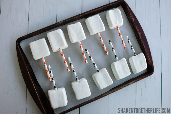 Quick and Easy Halloween Marshmallow Pops - these guys are ready to get dipped in chocolate and sprinkled!