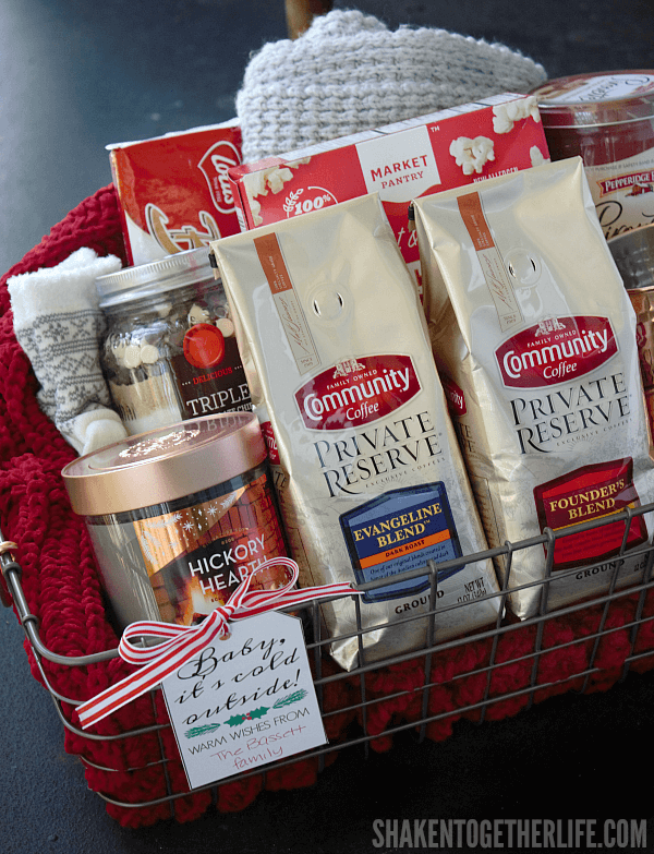 A Baby It's Cold Outside Gift Basket is perfect for sending warm wishes and lots of cozy ways to snuggle up this holiday season! Add the free printable gift tag for an easy, personal touch, too!