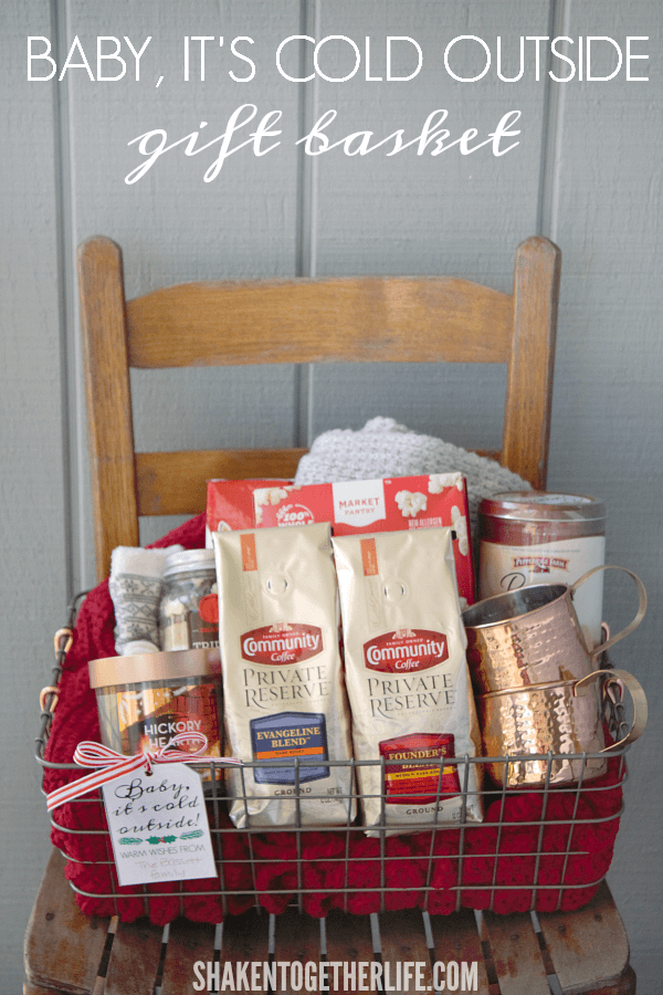 A Baby It's Cold Outside Gift Basket - filled with cozy winter wear, coffee + copper mugs, a candle and lots of sweet treats!