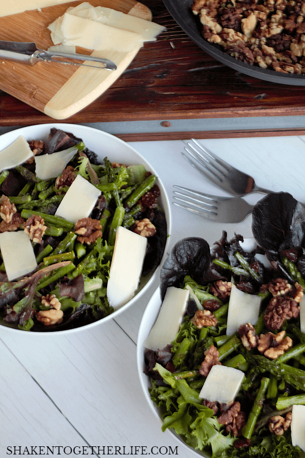 With a handful of healthy ingredients and about 10 minutes, you can enjoy this hearty warm Roasted Asparagus Salad with Walnuts & Asiago!