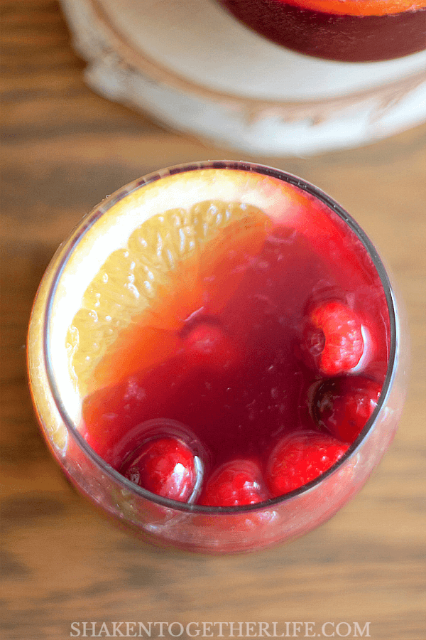 Garnish each glass of Sparkling Sangria Punch with an orange slice and bright red berries!