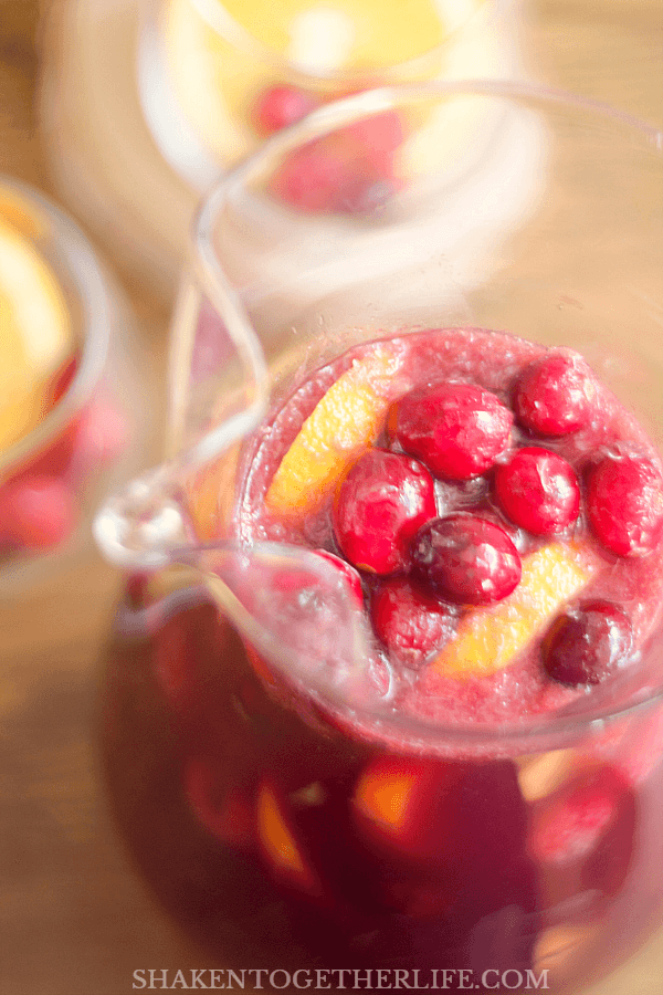 This Sparkling Sangria Punch is perfect for holiday parties - it isn't too sweet or boozy, so it will quickly become your entertaining go to!