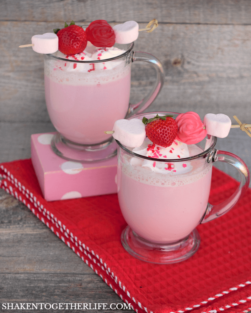 Cupid Cocoa - this is SO cute! Strawberry cocoa topped with whipped cream, sprinkles and a yummy kabob loaded with marshmallows, berries and gummy roses!