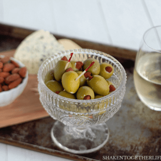 Almond & blue cheese stuffed olives are totally addictive and impossibly easy to make! A great addition to a cheese board or your game day spread!