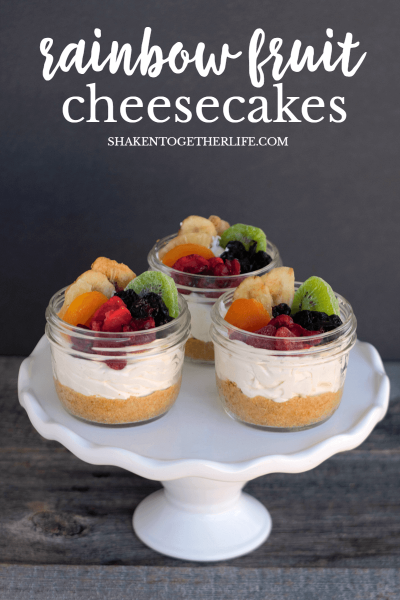 Rainbow Fruit Cheesecakes in a Jar with homemade graham cracker crust and rainbow fruit topping!
