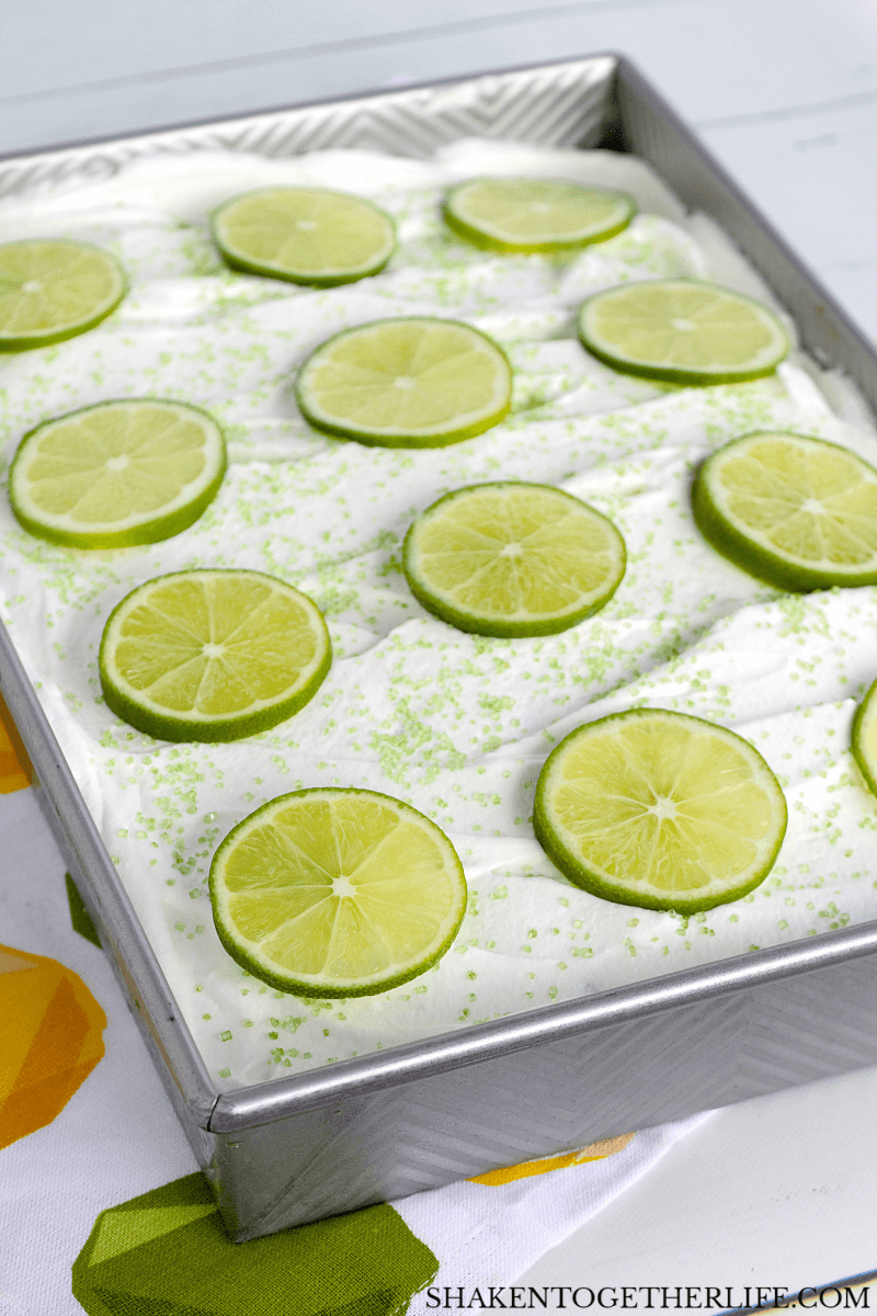 Simple and stunning, this Lime Poke Cake is topped with bright green lime slices!