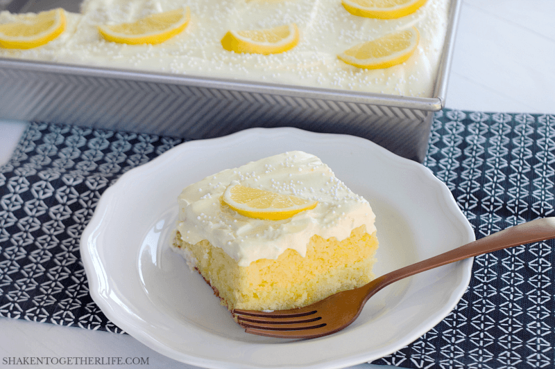 Triple Lemon Poke Cake - lemon lovers, this is for you! Soft lemon cake, lemon jell-o and fluffy lemon topping make this all lemon dessert irresistible!