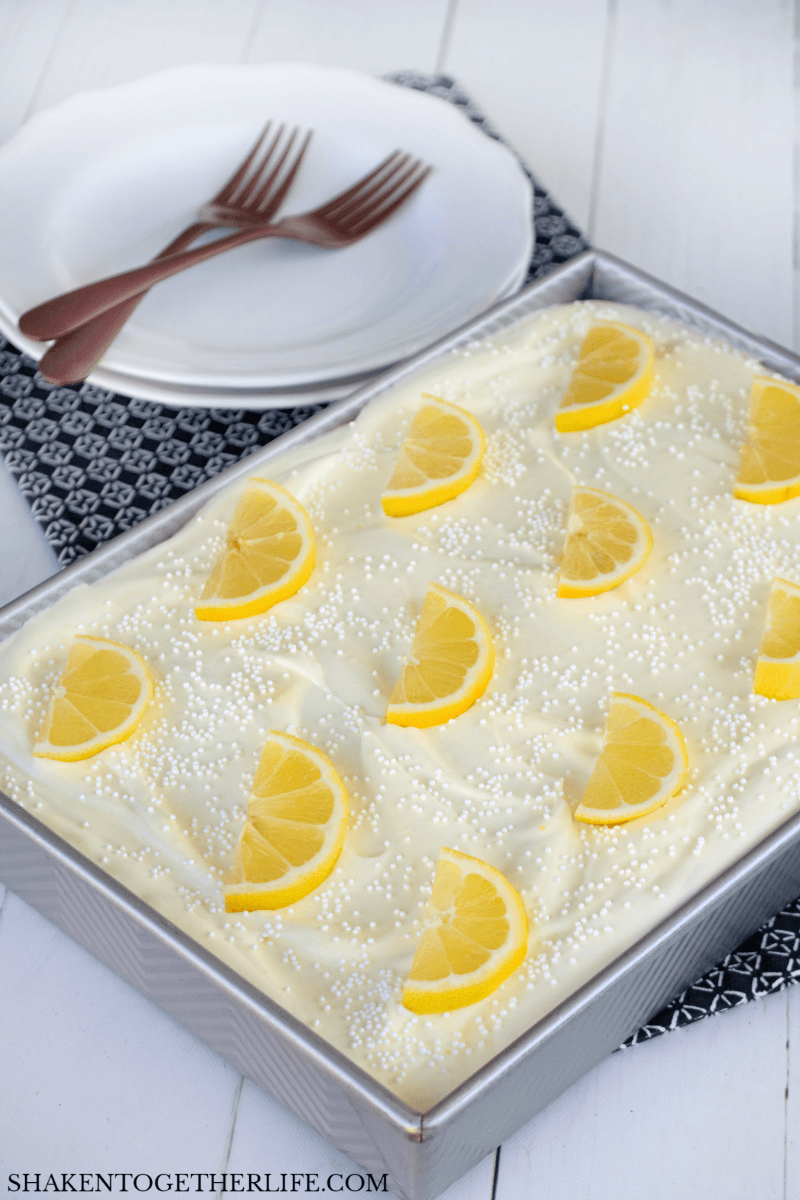Triple Lemon Poke Cake - the fluffy frosting adds more lemon flavor and a cool, creamy topping!