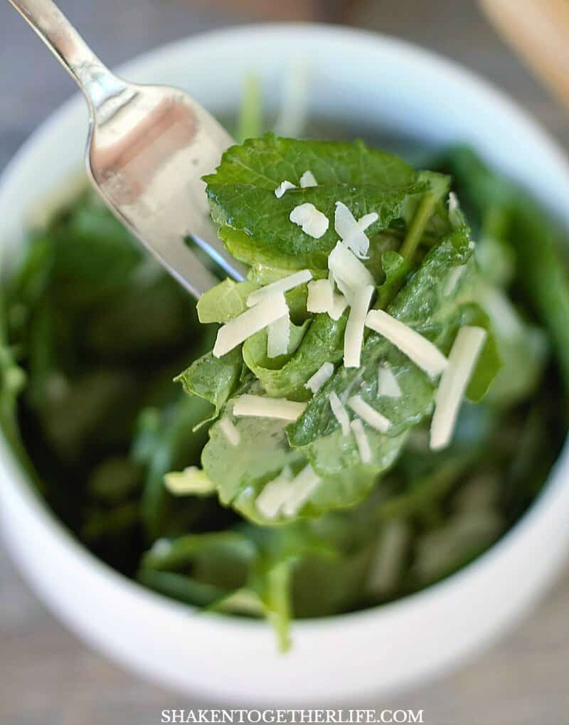 Lemon Garlic Kale Salad couldn't be easier - leafy greens, a bright lemon garlic dressing and a sprinkle of Parmesan cheese!