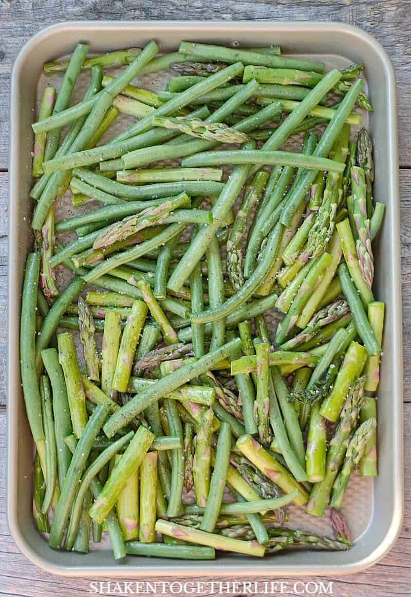 green beans and asparagus on baking sheet