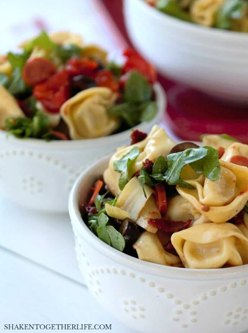 Tuscan Pasta Salad is a hearty Summer side dish that is the perfect partner to grilled Italian sausage, burgers or chicken!