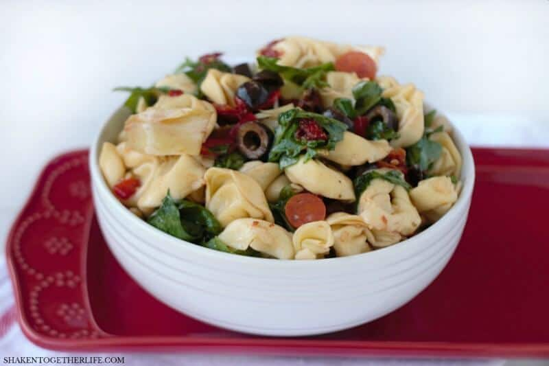Tuscan Pasta Salad is packed full of hearty cheese tortellini, Italian vegetables, olives and pepperoni and drizzled with an easy essential oil vinaigrette! This Summer side dish is a hit for picnic and potluck season!