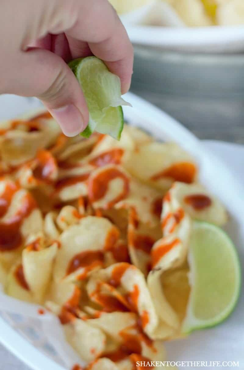 Mexican Street Chips - crispy salty potato chips, a drizzle of hot sauce and a squeeze (or six!) of lime! This is such a delicious appetizer or snack!