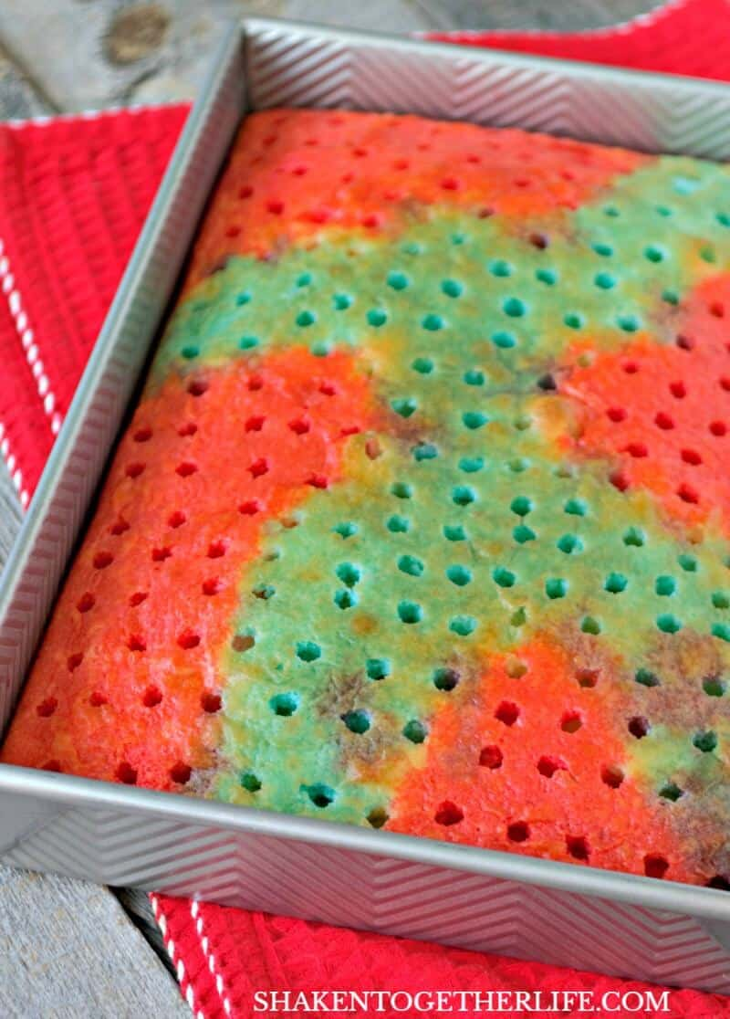 Carefully spoon red Jell-o over a portion of the cake for our Red, White & Blue Poke Cake