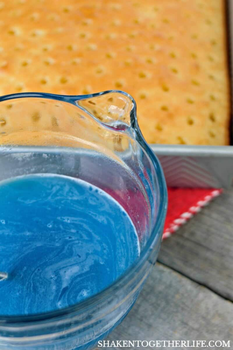 Blue Jell-o gives our Red, White & Blue Poke Cake one of its vibrant patriotic colors!