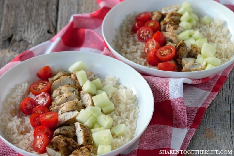 Make easy Greek Chicken Rice Bowls for that busy week night - just chop leftover chicken, add some diced veggies and dinner is served!