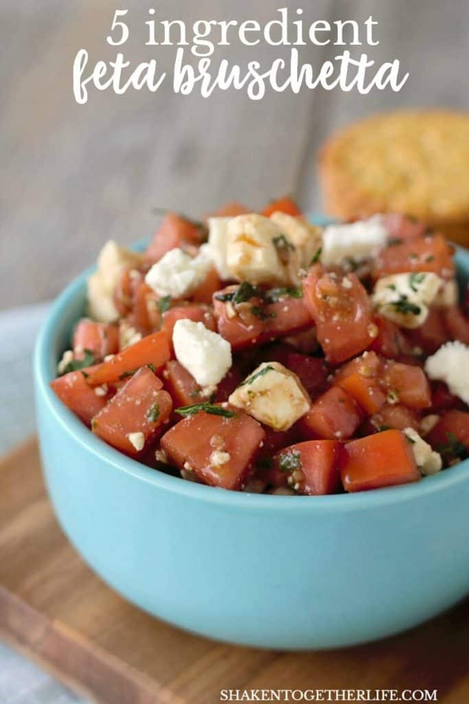 Bright tomatoes, fresh basil and creamy feta are the stars of this 5 ingredient Feta Bruschetta Recipe!