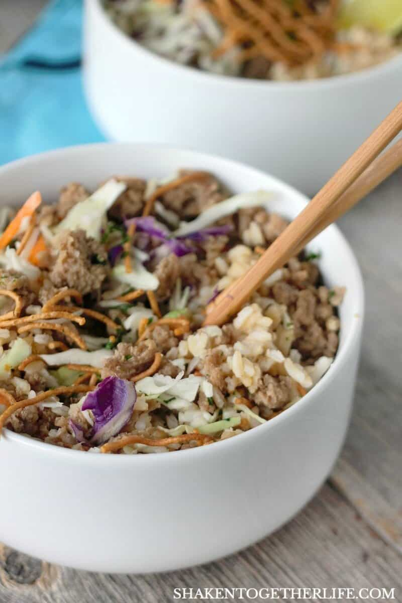 Korean Turkey Rice Bowls are filled with flavorful seasoned ground turkey, nutty brown rice, shredded cabbage and topped with crispy noodles for a quick and tasty weeknight meal!