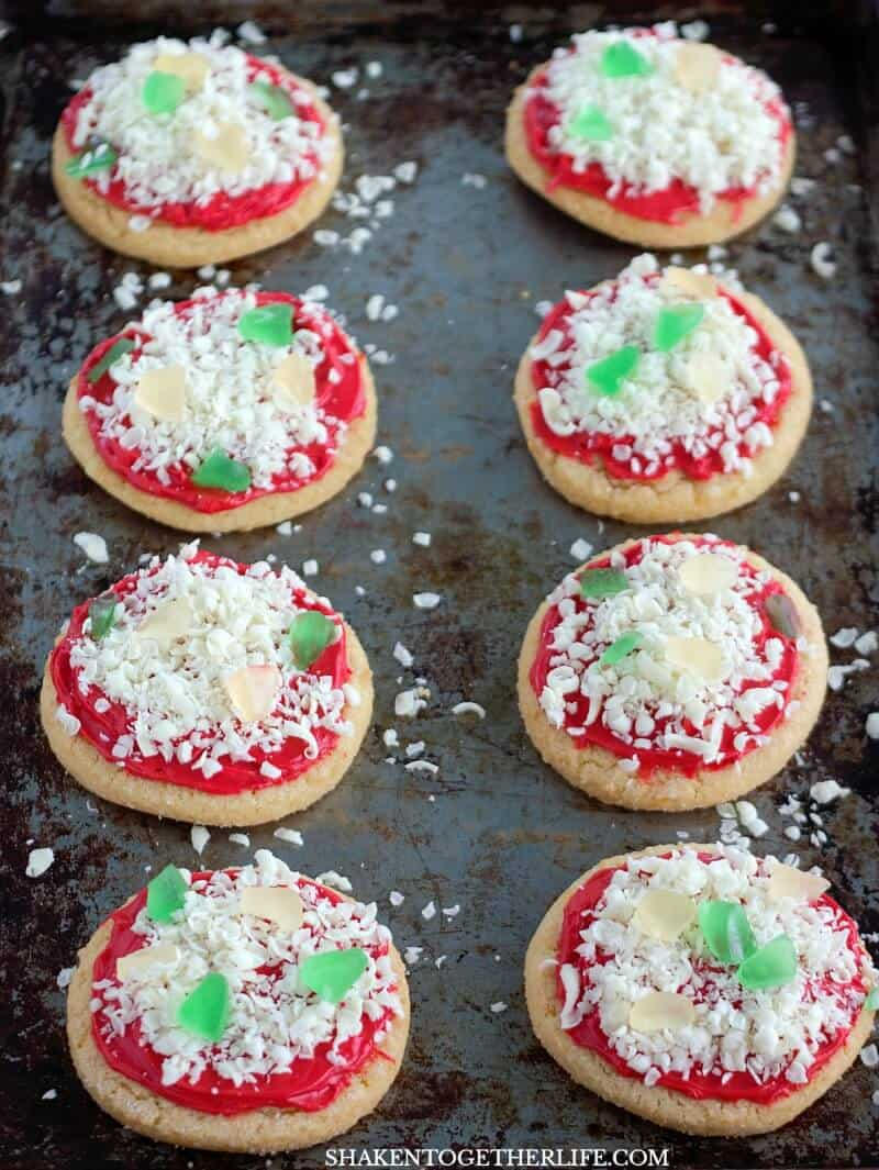 Chopped gummy worms (gummy bears work too) are the peppers and onions on these Sugar Cookie Pizza Cookies!