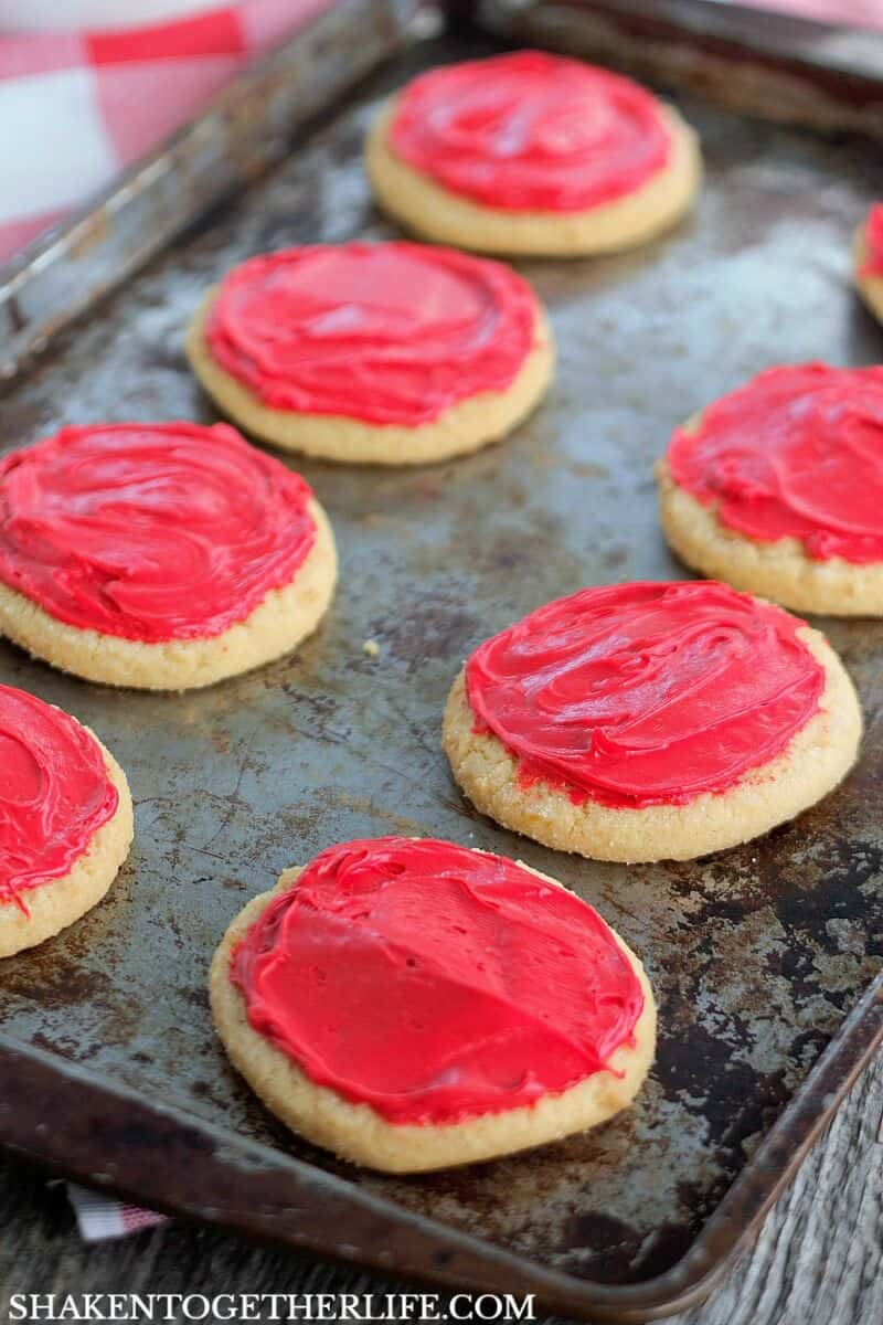 Red frosting is the 'sauce' on these super cute Sugar Cookie Pizza Cookies!